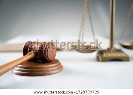 Сток-фото: Scales Of Justice And Gavel On Wooden Table And Lawyer Or Judge