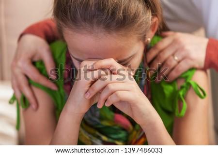 Sad teenager girl at counseling - woman professional hands holdi Stock photo © ilona75