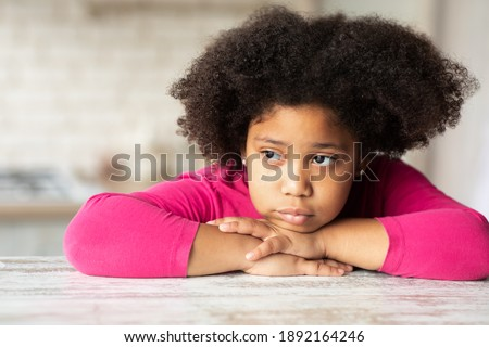Portrait of sad African American children leaning on table while parents arguing on the sofa at home Stock photo © wavebreak_media