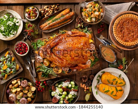 Festive table served for Thanksgiving or Christmas party with lamps above Stock photo © pressmaster