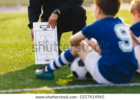 Soccer Team Meeting. Coach Giving Tactic Advices Using Football White Board. Coaching Youth Sports T Stock photo © matimix