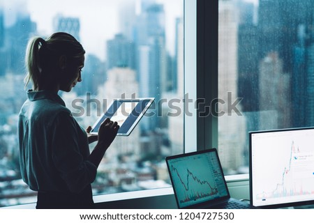 Hands of young contemporary female economist analyzing financial data Stock photo © pressmaster