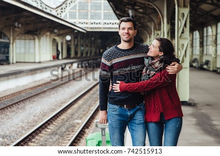 Romantic couple embrace at railway station, say good bye to each other. Affectionate wife hugs husba Stock photo © vkstudio