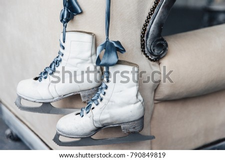 Photo of pair worn winter leather white skates for figure skating with shoelaces hang on ribbon. Use Stock photo © vkstudio