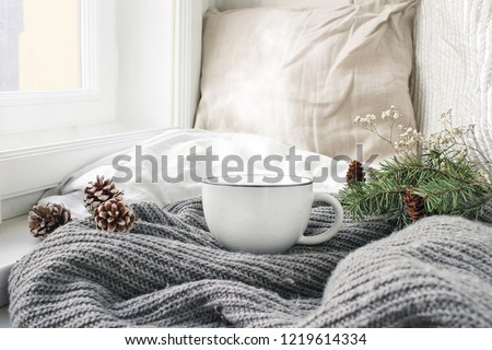 Comfortable cushions and white mug of hot drink in cozy living r Stock photo © dashapetrenko