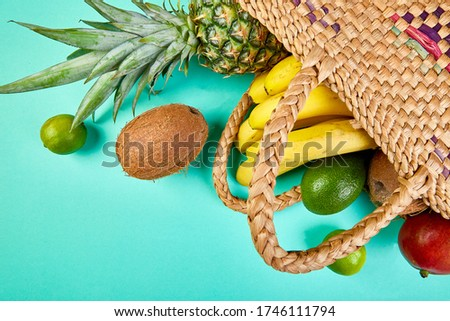 Grocery shopping bamboo bag with organic exotic fruits on pink background. Stock photo © Illia