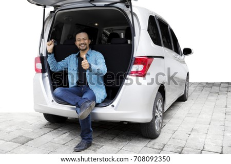 Photo of african american man showing ok sign and expressing surprise Stock photo © deandrobot