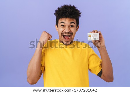 Photo of delighted african american man holding credit and sale cards Stock photo © deandrobot