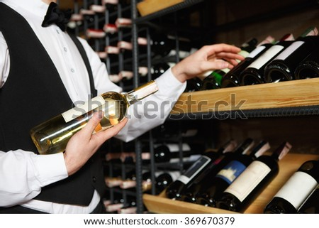 Sommelier with a glass each of red and white wines in a vineyard Stock photo © photography33