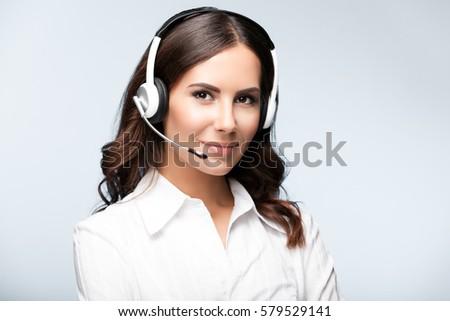 Uśmiechnięty kobiet call center agent zestawu biały Zdjęcia stock © wavebreak_media
