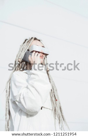 fiatal · szőke · lány · haj · szürke · kezek - stock fotó © lunamarina