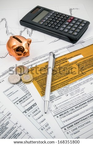 Piggybank on polish tax form. Coins and calculator in background Stock photo © simpson33