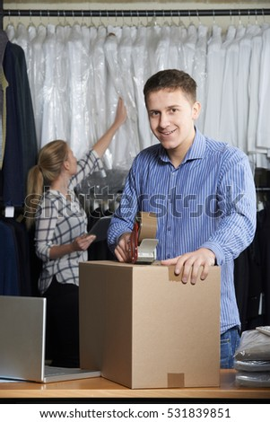 Couple Running Online Clothing Store Packing Goods For Dispatch Stock photo © HighwayStarz