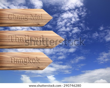 Wooden arrow sign pointing destination Bangkok, Chiang Mai, Thai Stock photo © scenery1