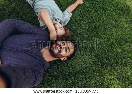 Parents with children lying on grass, view from top, head to hea Stock photo © Paha_L