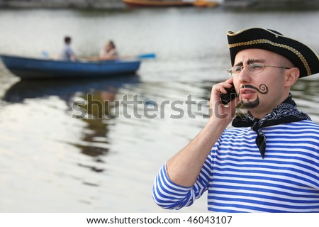 Man in pirate suit is talking by the phone. boat in out of focus Stock photo © Paha_L