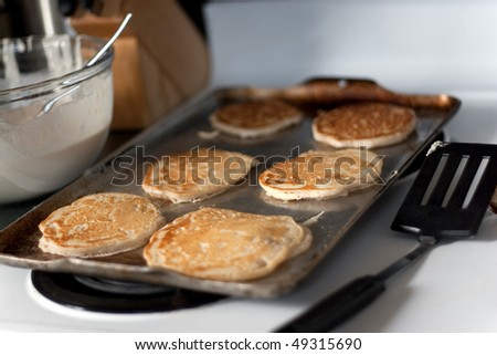 Palacsinták főzés forró tűzhely sekély mező Stock fotó © janssenkruseproducti