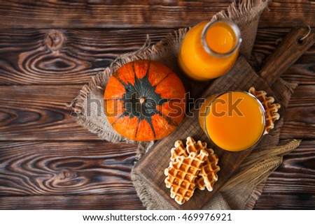 Bottle and Glass of fresh pumpkin juice with wafer and pumpkin o Stock photo © Yatsenko