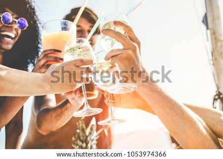 group of happy friends drinking tropical cocktails at boat party stock photo © disobeyart