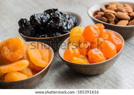 Organic prunes,dried plum,dried apricots on white background,wit Stock photo © ungpaoman
