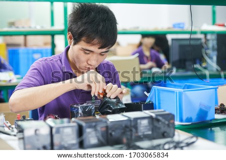 Asian worker in electronics factory Stock photo © studiostoks