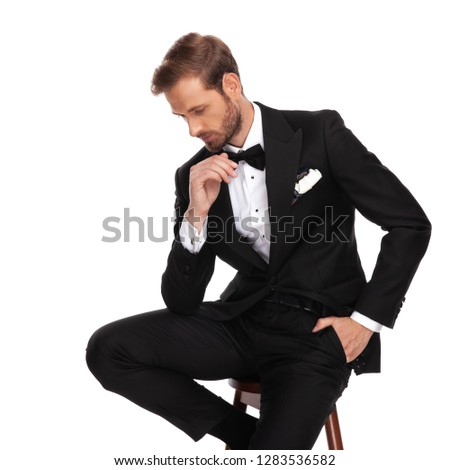 relaxed businessman sitting on wooden chair looks down to side Stock photo © feedough