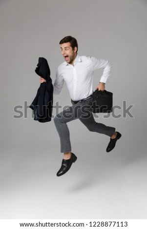 Full length image of caucasian unshaved businessman 30s in white Stock photo © deandrobot
