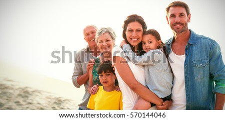 Front view of a multi-generation family posing together before having meal on dining table at home Stock photo © wavebreak_media