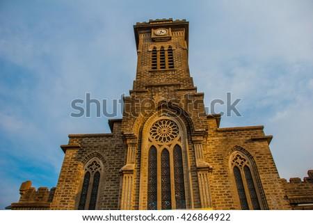 Hermosa piedra católico catedral Vietnam cruz Foto stock © galitskaya