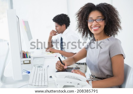 side view of young african american male and pretty mixed race female executives discussing over dig stock photo © wavebreak_media