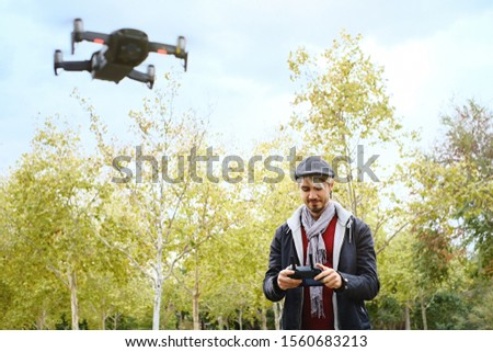 Young Man With Remote Control Learning To Fly Quadcopter Drone Stock photo © diego_cervo