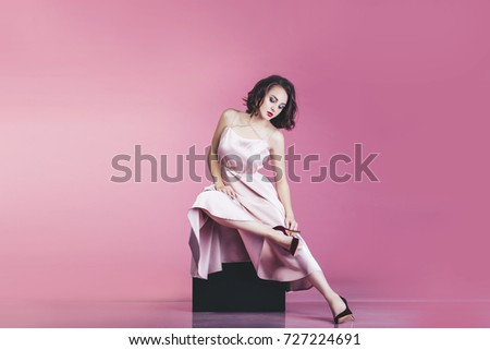 Slim legs of young woman in black glittering mini dress holding disco ball Stock photo © pressmaster