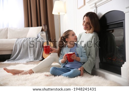 Children, rest and domestic atmosphere. Happy little female child wears nightclothes, cuddle small d Stock photo © vkstudio