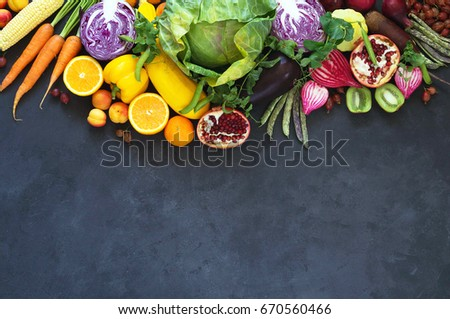 Stock photo: Mixed green fruits and vegetables placed on black wooden table