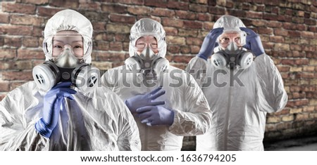 Caucasian Woman, Man and Chinese Man In Masks, Goggles and Hazma Stock photo © feverpitch