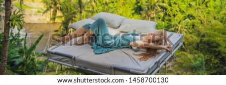 Young woman in bed over the jungle. Intimacy with nature BANNER, LONG FORMAT Stock photo © galitskaya