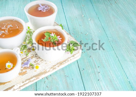 Banner of A cup of mint tea with chamomile on a wooden background. Stock photo © Illia