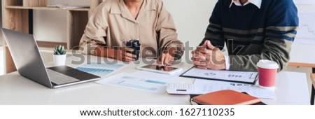 Businessman crew and his young partner colleagues discuss ideas  Stock photo © snowing