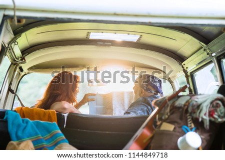 Rear view of a Caucasian man sitting in back of camper van while his friends are sitting in front se Stock photo © wavebreak_media