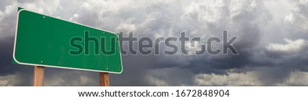 Blank Green Road Sign Against Ominous Cloudy Stormy Sky Backgrou Stock photo © feverpitch