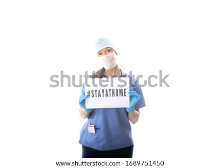 Nurse holding a sign to STAY AT HOME during virus COVID-19 pande Stock photo © lovleah