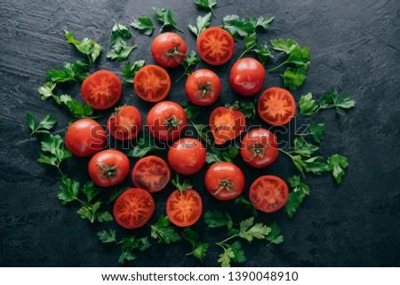 Yarım domates yeşil maydanoz etrafında karanlık Stok fotoğraf © vkstudio