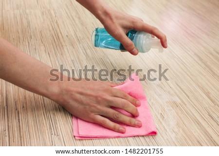 Hand in glove cleaning laminate floor Stock photo © simazoran