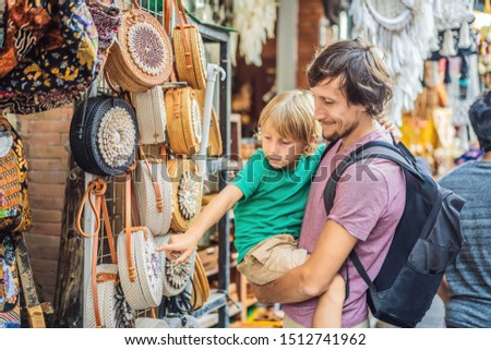 Dad and son at a market in Ubud, Bali. Typical souvenir shop selling souvenirs and handicrafts of Ba Stock photo © galitskaya