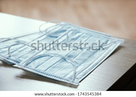 Health-care horizontal background from medical masks. Top view. Stock photo © artjazz