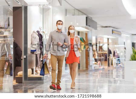 Virus, pandemic, quarantine. Man shopper wears medical mask, gloves protects from coronavirus, walks Stock photo © vkstudio