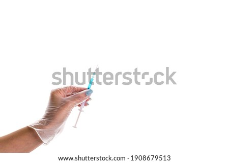 Medical vial and syringe in doctors hand against white background. Vacciantion against infectious di Stock photo © vkstudio
