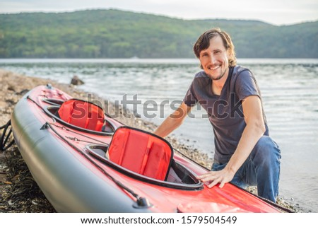 Caucasian Men Preparing For a Kayak Trip on the sea. Summer Recreation BANNER, LONG FORMAT Stock photo © galitskaya