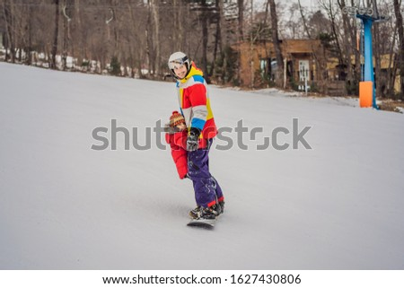 Dad and son ride the same snowboard, breaking safety precautions Stock photo © galitskaya