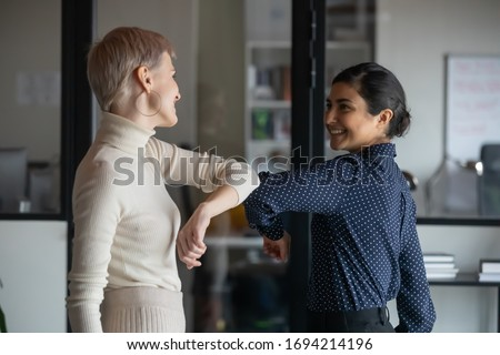 Two colleagues avoid a handshake when meeting in the office and  Stock photo © boggy